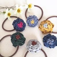 革のお花のヘアゴム* - codica
