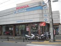 親から引き継いたこの店 - バイクの横輪