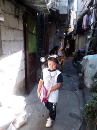Walking through the narrow path to their school - SONGS