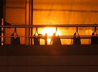Sunset reflected in the window - はーとらんど写真感