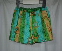 386.ミドリオレンジのパンツ - フリルの子供服