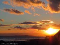 夕陽に染まる海と嘱託書交付式の写真 - Photo Album