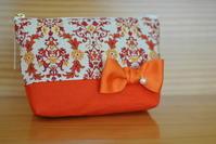 オレンジ色のパール付きリボンポーチ。 - COCO-NE じかん