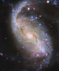 ハッブル宇宙望遠鏡が捉えた最新のかじき座の棒渦巻型銀河NGC1672 - 秘密の世界        [The Secret World]
