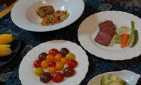 庭のトマトのサラダ - 二つの台所