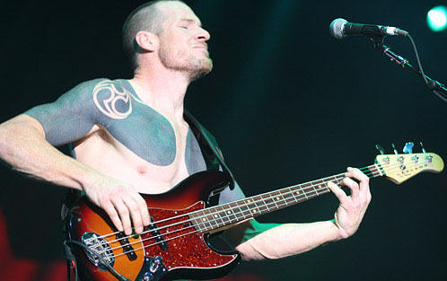 tim commerford tattoo. Bio mechanical face tattoo girl suing a tattoo artist