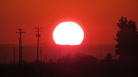 130221 ルート99号線、地平線に沈む真っ赤な太陽_d0288367_1116343.jpg